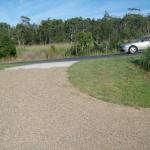 Concrete driveway crossing and roadbase driveway.
